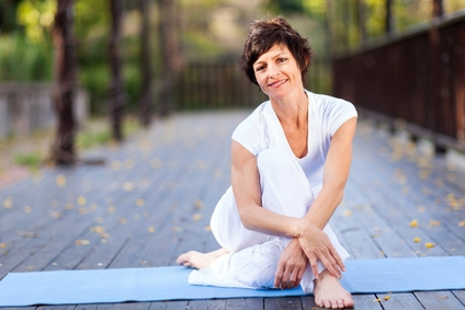 fit middle aged woman relaxing after workout