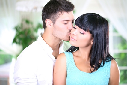 Beautiful young romantic couple in cafe