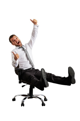 excited businessman sitting on chair. isolated on white background