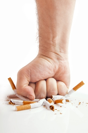 Human fist breaking cigarettes - anti-smoking concept