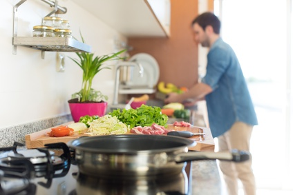 Man in kitchen cooking lunch - Focus on food